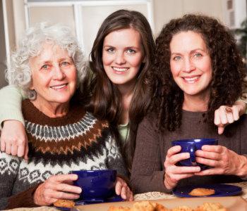 elderly women and caregiver smiling