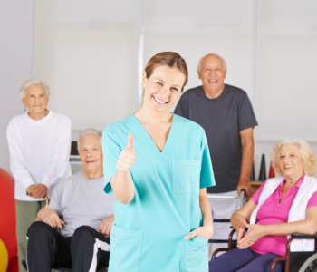 caregiver smiling doing thumbs up